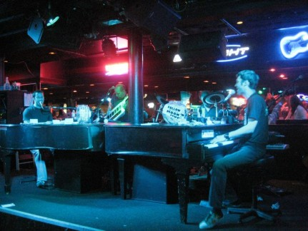 Two piano players & their band, cranking out the tunes