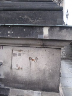 Bullett holes and shrapnel marks are visible on a lot of buildings if you look closely.