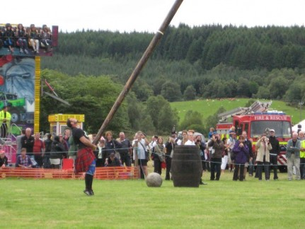 Caber tossing is an event at these primitive style Olympics. Only for the strongmen. Check out the stone ball and barrel too. Seven guys from the crowd (including Pete) tried and failed to get that ball off the ground, let alone onto the barrel. These competitors make it look easy.