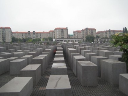 This is a Holocaust Memorial (built between 2003 and 2005). The design represents a radical approach to the traditional concept of a memorial , partly because it has no symbolism. People have many different interpretations. There are 2711 concrete stelae. Way less than representing one per person.