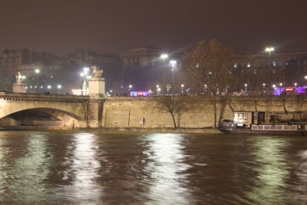The lights of Paris and the Seine River from the river cruise.
