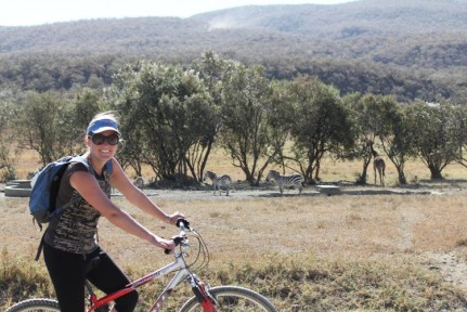 Elissa riding through Hell's Gate NP. A great way to explore a National Park, a highly recommended optional extra...
