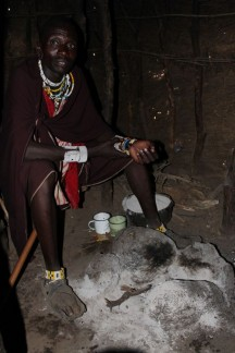 Inside a Masai Home... It is so tiny that you duck down to enter and then sit on their bed which is in front of where they cook...