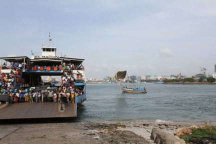 A packed ferry makes its way to Stone Town...