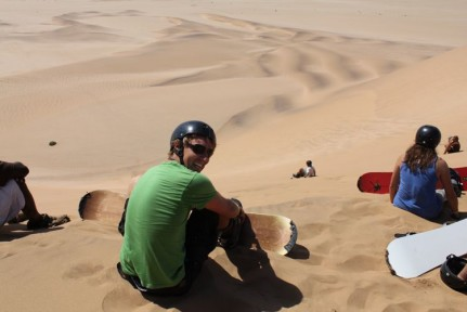Stand up sand boarding is exactly like snow boarding except for the obvious. Oh and the fall is a little harder on the sand...