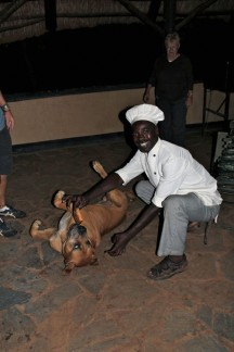 Our amazing cook Dom with a dog that has the biggest head we had ever seen...