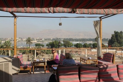 Elissa on the terrace of our hotel in Luxor. Nile river in the back ground
