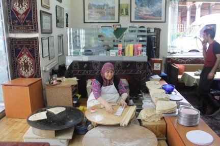 This Turkish Mama sits here all day rolling dough and making Gozleme after Gozleme. They are so tasty...
